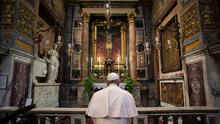 In prayer: Pope Francis prays in San Marcello al Corso church, in front of a crucifix that in 1552 was carried around Rome to stop the great plague. Vatican News via AP