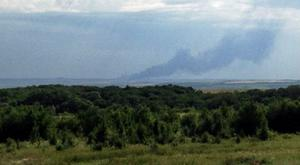 Smoke rises rises from the crash site of Malaysia MH17 shortly after it was believed to have been shot down over Ukraine