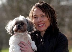 Julie Cashell, 38 from Powys, Wales with her Lhasa Apso who helps to bring happiness to people with Dementia living in Oaklands care home, during their Crufts 2015 shortlist announcement in Green Park, London for the Eukanaba Friends for Life competition in, which celebrates uplifting stories of friendship in adversity. PRESS ASSOCIATION Photo. Picture date: Monday February 23, 2015. See PA story ANIMALS Crufts. Photo credit should read: Hannah McKay/PA Wire