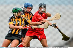 14 September 2014; Aoife Murray, Cork, in action against Shelly Farrell, left, and Michelle Quilty, Kilkenny. Liberty Insurance All Ireland Senior Camogie Championship Final, Kilkenny v Cork, Croke Park, Dublin. Picture credit: Ramsey Cardy / SPORTSFILE