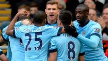 Manchester City striker Edin Dzeko celebrates with teammates after scoring his side's equalising goal in their Premier League clash with Liverpool at Anfield. Photo: OLI SCARFF/AFP/Getty Images