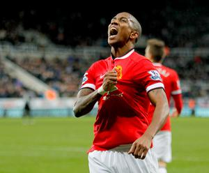 Ashley Young celebrates after scoring the only goal of the game at St James' Park