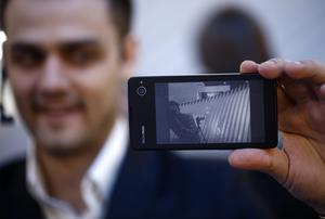 The reverse side of a YotaPhone smartphone is arranged for the photograph at the Yota Devices pavilion on day two of the Mobile World Congress in Barcelona.