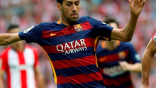 Barcelona's Sergio Busquets fights for the ball during their Spanish first division soccer match at San Mames stadium in Bilbao