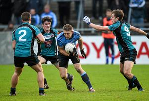 Dublin's Eoghan O'Gara in action against Maynooth University trio Conor Carton, David Hyland and Padraig Faulker during their O'Byrne Cup clash at Parnell Park. Photo: Pat Murphy / SPORTSFILE