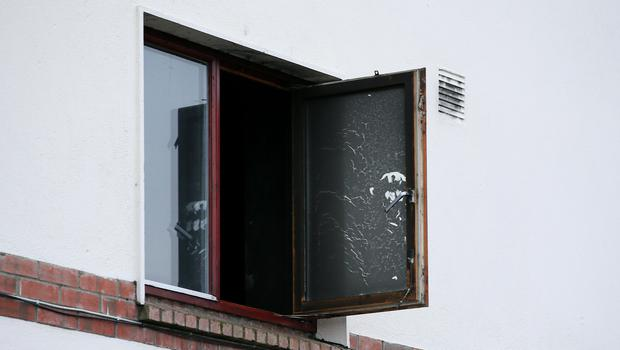 Smoke damaged window at the apartment where a woman and two children died in a fire ,on Kilcronan Avenue in Clondalkin. (Image: Frank Mc Grath)