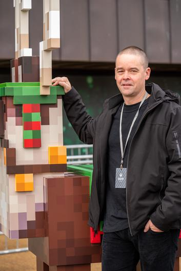 Saxs Persson, head of Minecraft Earth and creative director of the Minecraft franchise, at XO19 where the cold, damp weather made demoing the game outside fun
