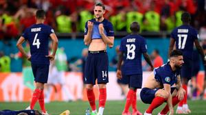 Players of France look dejected after team mate Kylian Mbappe (not pictured) misses their side's decisive penalty