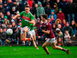Michael Plunkett of Mayo in action against Micheal Boyle of Galway. Photo by Harry Murphy/Sportsfile