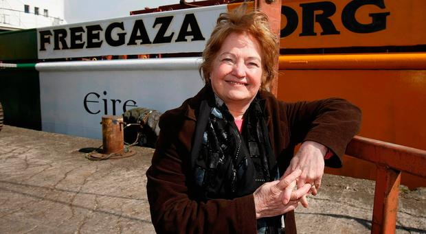 Mairead Maguire stands beside the Cargo ship the MV Rachel Corrie: Niall Carson/PA Wire