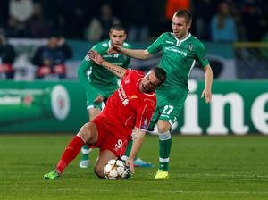 Liverpool's Rickie Lambert, centre, is challenged by Ludogorets' Cosmin Moti during the Champions League Group B soccer match between Ludogorets and Liverpool at Vassil Levski stadium in Sofia, Bulgaria (AP Photo/Darko Vojinovic)