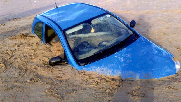 From the position of the car and the depth to which it was buried, it could be seen that the tide had washed in and out over the car several times