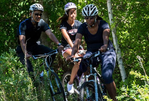 US President Barack Obama goes biking with his wife Michelle and daughter Malia at Martha's Vineyard in Massachusetts during their annual summer vacation on the island. Photo: NICHOLAS KAMM/AFP/Getty Images