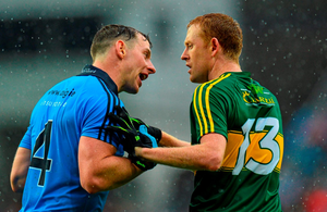 Dublin's Philly McMahon and Kerry's Colm Cooper in conversation after the game