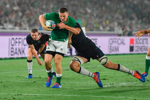 Andrew Conway of Ireland goes over to score his side's fourth try despite the tackle of Grant Gilchrist of Scotland during the 2019 Rugby World Cup Pool A match between Ireland and Scotland at the International Stadium in Yokohama, Japan. Photo by Brendan Moran/Sportsfile