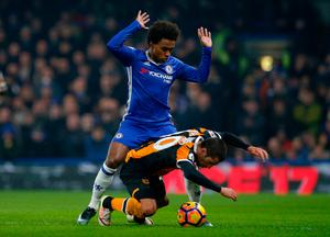 Hull City's Evandro Goebel in action with Chelsea's Willian. Photo: Reuters / Andrew Couldridge