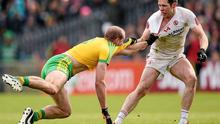 Tyrone captain Sean Cavanagh gets involved in a tussle with Donegal's Neil Gallagher off the ball