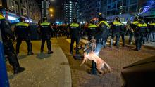 Dutch riot police charges after riots broke out at a pro Erdogan demonstration outside the Turkish consulate in Rotterdam, Netherlands on Saturday night (AP Photo/Peter Dejong)