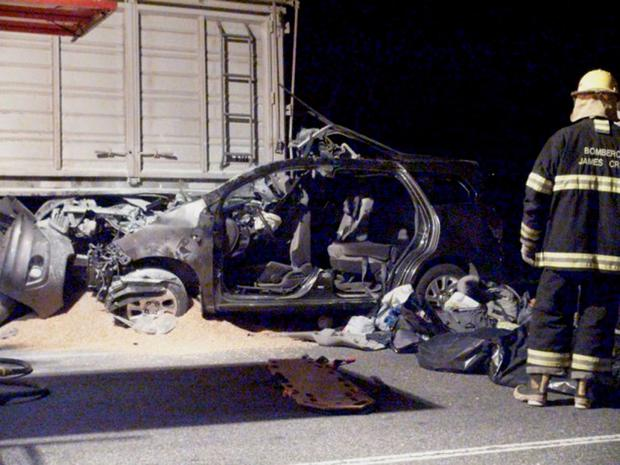 A TV still image shows a firefighter standing next to a car, trapped underneath a truck, in which three relatives of Pope Francis were killed near James Craik, Cordoba province. A nephew of the pope, Emanuel Bergoglio, who was driving the car was in serious condition after the accident. The nephew's wife and two children aged two years and eight months died, said media citing police and hospital sources. Reuters/DyN-www.noticraik.com