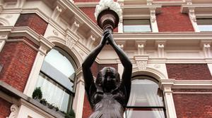 One of the statues outside the Shelbourne Hotel before it was removed. Photo: Martin Maher
