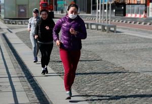 People follow social distancing guidelines as they go for a run in Dublin's city centre. Photo: Brian Lawless/PA Wire