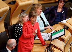 Scotland's First Minister, and leader of the Scottish National Party Nicola Sturgeon, speaks during First Minister's questions at the Scottish Parliament in Edinburgh, Scotland, Britain, May 6, 2015. REUTERS/Russell Cheyne