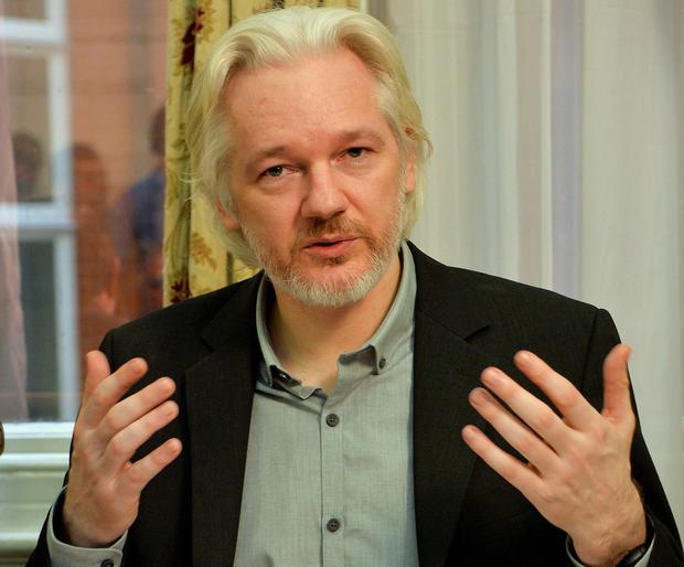 WikiLeaks founder Julian Assange gestures during a news conference at the Ecuadorian embassy in central London. Assange, who has spent over two years inside Ecuador's London embassy to avoid extradition to Sweden, said on Monday he planned to leave the building 'soon', without giving further details. Reuters