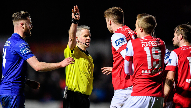 St Patrick's Athletic players remonstrate with referee Sean Grant. Photo by Sam Barnes/Sportsfile
