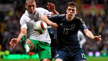 Ireland forward Jonathan Walters challenges Andrew Robertson of Scotland for the ball during the Euro 2016 qualifier at Celtic Park. Photo: Stephen McCarthy / SPORTSFILE
