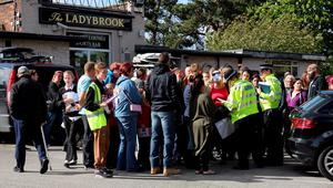 Volunteers from the local community gather at The Lady Brook sports bar near to the home of missing teenager Amber Peat in Mansfield as police organise people into small groups to search the local area. Chris Radburn/PA Wire