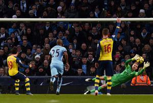 Santi Cazorla beats Joe Hart from the penalty spot to open the scoring for Arsenal in their win over Manchester City at the Etihad. Photo: PAUL ELLIS/AFP/Getty Images