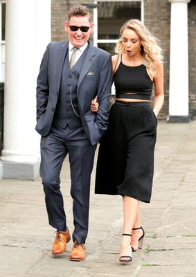 Former Coronation Street actress Sacha Parkinson and a unidentified male guest, make their way to St Mary's Church in Bury St Edmunds, Suffolk, for the wedding of former Coronation Street actress Michelle Keegan to The Only Way Is Essex star Mark Wright. PRESS ASSOCIATION Photo. Picture date: Sunday May 24, 2015. See PA story SHOWBIZ Keegan. Photo credit should read: Yui Mok/PA Wire