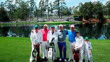 Shane Lowry of Ireland, Stephen Gallacher of Scotland and Padraig Harrington of Ireland pose with their caddies during the Par 3 Contest prior to the start of the 2015 Masters Tournament at Augusta National Golf Club on April 8, 2015 in Augusta, Georgia.  (Photo by Andrew Redington/Getty Images)