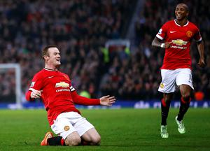 Wayne Rooney celebrates after scoring Manchester United's second goal in their Premier League win over Hull City at Old Trafford. Photo: Darren Staples/REUTERS