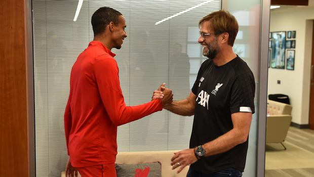 Liverpool's Joel Matip, pictured with Jurgen Klopp, is back in full training