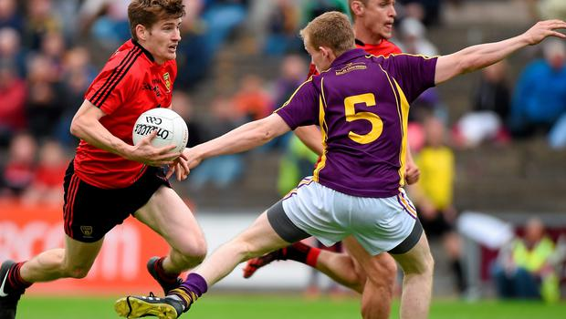 Down's Conor McGinn in action against Wexford's Simon Donohoe