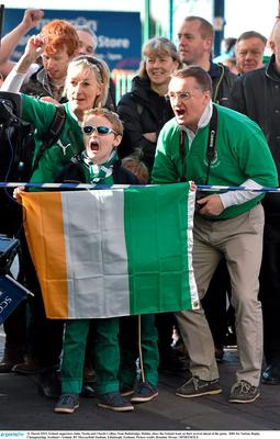 21 March 2015; Ireland supporters John, Nicola and Charlie Collins, from Ballsbridge, Dublin, cheer the Ireland team on their arrival ahead of the game.  RBS Six Nations Rugby Championship, Scotland v Ireland. BT Murrayfield Stadium, Edinburgh, Scotland. Picture credit: Brendan Moran / SPORTSFILE
