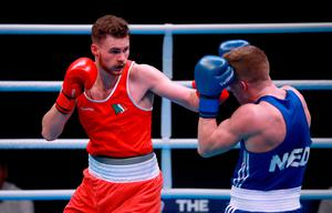 Ireland's Michael Nevin (left) and Netherland's Max Van der Pas compete in the preliminaries of the Men's Middleweight competition during day three of the Boxing Road to Tokyo 2020 Olympic qualifying event at the Copper Box Arena, London.