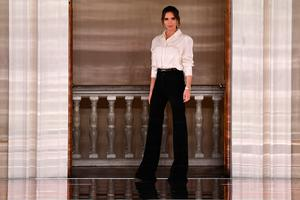 British fashion designer Victoria Beckham reacts after presenting creations for her Autumn/Winter 2020 collection on the third day of London Fashion Week in London on February 16, 2020. (Photo by DANIEL LEAL-OLIVAS / AFP)