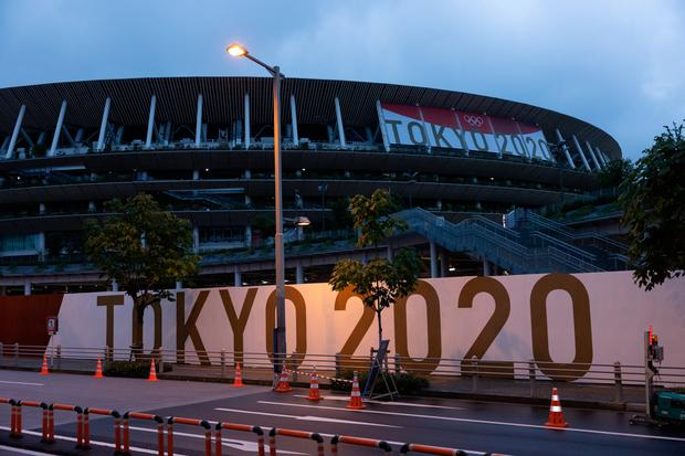 Branding is displayed on a fence surrounding the Olympic Stadium in Tokyo, Japan