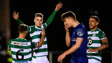 Rhys Marshall celebrates with his Shamrock Rovers team-mates Greg Bolger, left, and Lee Grace, right