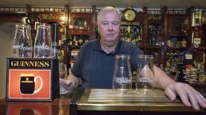 Defiant: Publican John Byrne behind the bar at Byrne's of No 10 in Dundalk,  Co Louth. PHOTO: ARTHUR CARRON
