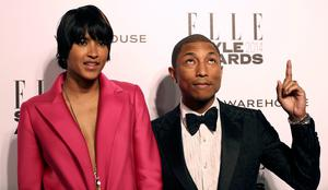 Singer Pharrell Williams and his wife Helen Lasichanh arrive at the Elle Style Awards in London February 18, 2014