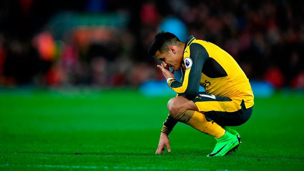 Arsenal's Alexis Sanchez looks dejected during his side's visit to Liverpool Photo: Laurence Griffiths/Getty Images