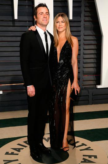 Actress Jennifer Aniston and husband Justin Theroux at a post-Oscars party Picture: Reuters