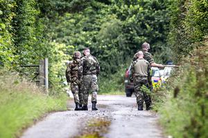 Members of the Defence Forces and the Garda dog unit carry out a search in Gormanston, Co Meath. Picture: David Conachy