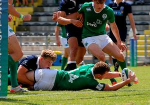 Stephen Fitzgerald touches down to score a try for Ireland