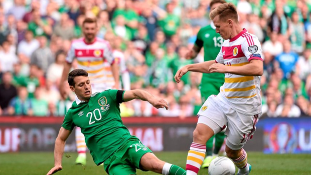 Wes Hoolahan in action against Matt Ritchie of Scotland.