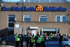 Dublin Bus drivers stand outside a depot this morning (Picture: Mark Condren)