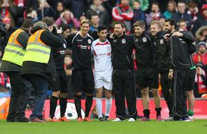 Football - Steven Gerrard All-Stars v Jamie Carragher All-Stars - Liverpool FC Foundation Charity Match - Anfield - 29/3/15 (From L-R) Luis Suarez, Fernando Torres, Luis Garcia, Xabi Alonso, Steven Gerrad, Dirk Kuyt and Alvaro Arbeloa at the end of the match Action Images via Reuters / Alex Morton Livepic EDITORIAL USE ONLY.